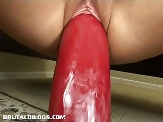 Amateur blonde bouncing up and down on a gigantic dildo