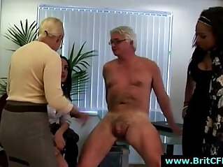 Mature British femdom lady and two younger girls punish CFNM guy in office