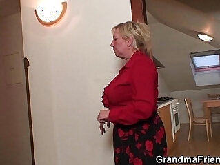 Two repairmen fuck with busty grandma from both ends